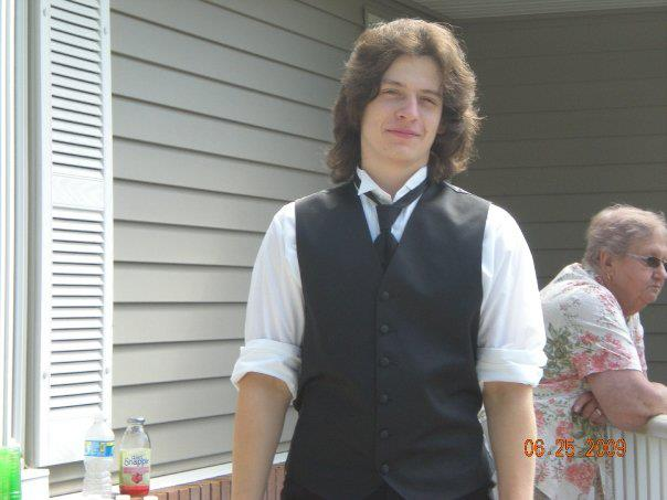 Long hair and a suit...Kyle doesn't look too different from my friends when I was 18.