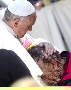 Pope Francis praying over leper