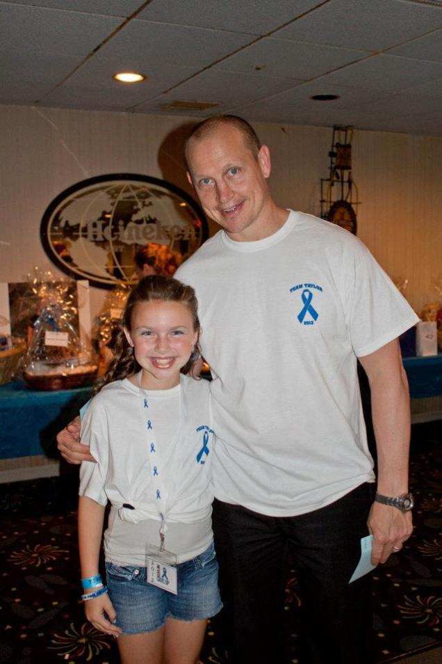 Taylor Ryan and her good friend, the legendary Adam Graves at one of Taylor's Histio Awareness Fundraisers.  Both are sporting Ts created for the event.