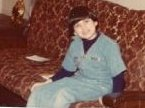 I was about 6 or 7 years old here sitting on my Aunt Carol's couch.  I used to love to go there for visits.  They had such a fun, happy house.