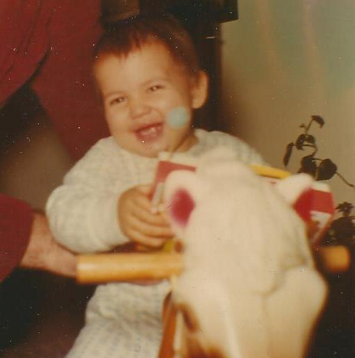 I am thinking I am about 16 months old here.  Nothing quite  like the innocent smile of a happy baby.